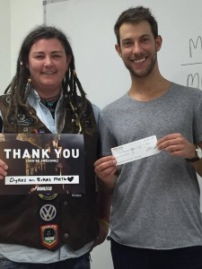 President Jo Bangles donating a cheque to Micah of Minus18.